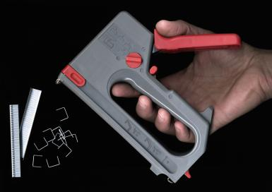 Man holding a staple gun