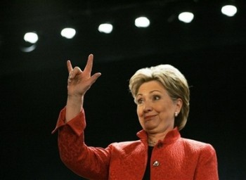 "Democratic presidential hopeful Sen. Hillary Rodham Clinton, D-N.Y., signs ""I love you"" to the crowd during a campaign rally in Scranton, Pa., Monday, April 21, 2008. (AP Photo/Elise Amendola)"