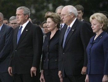 President Bush, left, along with, from second from left, first lady Laura Bush, Vice President Dick Cheney and his wife, Lynne Cheney, stand with White House staff and members of Congress as they take part in a moment of silence, marking the sixth anniversary of the Sept. 11 terrorist attacks, Tuesday, Sept. 11, 2007, on the South Lawn of the White House in Washington. (AP Photo/Lawrence Jackson)