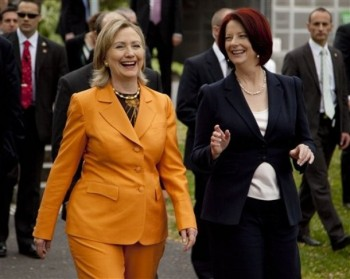 U.S. Secretary of State Hillary Rodham Clinton, left, walks to lunch with Australian Prime Minister Julia Gillard on Sunday, Nov. 7, 2010, in Melbourne, Australia. (AP Photo/Evan Vucci, Pool)