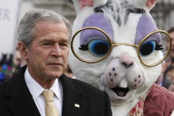President Bush stands with a bunny character as they watch the start of the White House Easter Egg Roll, Monday, March 24, 2008, on the South Lawn at the White House in Washington. (AP Photo/Ron Edmonds)